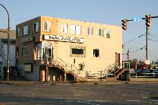 "Proudly displaying Polish, Irish and Italian flags, the Malamute at South Park and Michigan has long been a favorite of the working man ""Genny"" drinker. The tavern is across the street from the former DL&W railroad terminal and site of the future Seneca Buffalo Creek Casino."