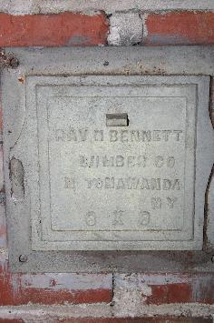 Click image to enlarge: Bennett iron name plate in basement.