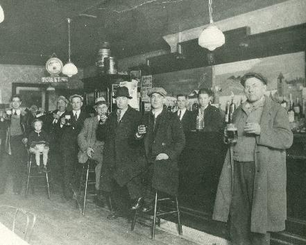Adam's Tavern, Buffalo, New York, 1933. The regulars returned to Adam's Tavern, 1012 Sycamore (at Loepere) to hoist some brews and, it would appear, a shot or two as well shortly after the repeal of Prohibition in 1933. Adam Pilarz, proprietor, stands behind the bar along side his son John. The family ran the tavern from 1924 until 1949. Thank you to Ed Pilarz for sharing this priceless family picture.