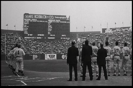 "Image from film: News Reel sequence from Knights Field. Buffalo's War Memorial Stadium was fitted with 1930s scoreboard. Note ""Rich Products"" ad in right field."