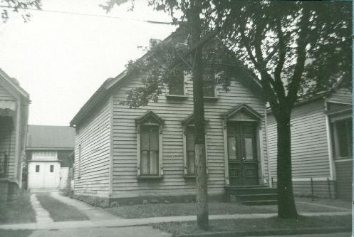 24 Coit Street: Typical of the thousands of wood framed dwellings built by German developer Joseph Bork. It was Bork who donated the land for St. Stanislaus Parish. This picture was take in the early 1940s. In addition to Bork, ownership of the property can be traced back to Charles Townsend (Townsend St.), Guilford Wilson (Wilson St.) and George Coit for whom the street is named after. The lot size is 30 feet (Front) by 108 feet (Deep). The barn in the rear of the picture was built by the Broadway Brewing & Malting Company and still stands today (2006).
