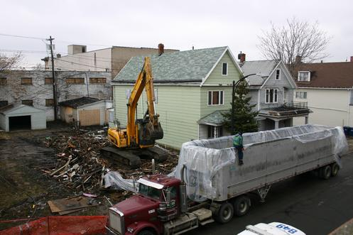 Efforts to preserve the unique urban fabric of Gibson & Lombard Streets, the residential and commercial corridors that boarder the Broadway Public Market in the Historic Polonia District, experienced a major setback. On Wednesday March 29th, fire destroyed a 2 ½ story home at 210 Gibson. Emergency demolition brought the remains of the home down a few days later. The demolition of 210 Gibson follows the removal of 218 Gibson, a former tavern, last May. A neighboring home in deteriorating condition at 214 Gibson most likely will be torn down this spring.