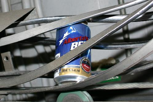Part of the canning conveyor belt system. Empty cans make their way down the belt to the filling machines
