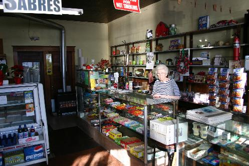 Business is slow nowadays says the 90 year old owner. Candy, pop and the Buffalo News are the biggest sellers.
