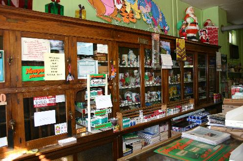 Smokes, greeting cards, playing cards, pipe cleaners and school tablets are still offered for sale.