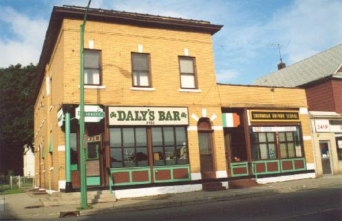 "Daly's at 2423 Seneca Street. A few doors down from Cannan�s Funeral Parlor, owner Bill Daly says a good wake is good for the bar business. Daly, a former ironworker, bought the tavern in 1957. The last South Buffalo stop before you hit the cityline, the parade crowds make this trip. ""Being out this far, they're half pissed up by the time they get here,"" said a somber Daly."
