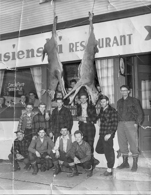 Back at the tavern after deer hunting. Owner John Strusienski (3rd from the left) and above him (in the window) is Julia �Ma� Strusienski.
