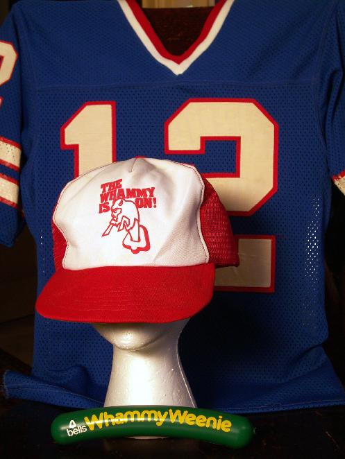 From Steve Cichon�s StaffAnnouncer.com: A collection of Bells Whammy paraphernalia. A vintage Joe Ferguson jersey is an appropriate backdrop for a 1982 Weenie and a hat promoting the 1983 Talking Proud replacement Whammy.